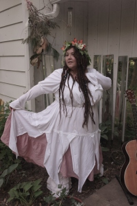 Magnolia Magpie recites poems in a hand sewn Beltane gown: magnoliamagpie@societyofmossandlace.com