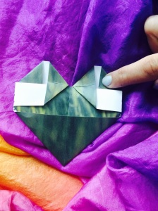 Fold the other upper corner down to square the bottom edge.